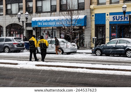 Stamford, CT, USA - March 20th, 2015: Daytime scene of people in downtown Stamford Connecticut on March 20th, 2015 during a snow storm
