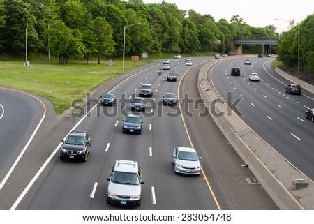 Stamford, CT, USA - May 29, 2015: Daytime traffic on the interstate highway on May 29, 2015 in Stamford Connecticut  - stock photo