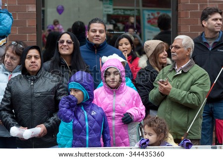 "Stamford, CT, USA - November 22, 2015: Spectators enjoying the annual ""Thanksgiving Day"" parade in downtown Stamford on November 22, 2015."