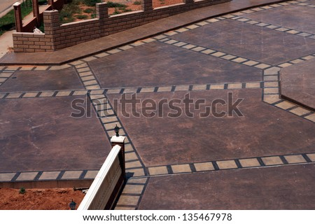 stamped and stained driveway - stock photo