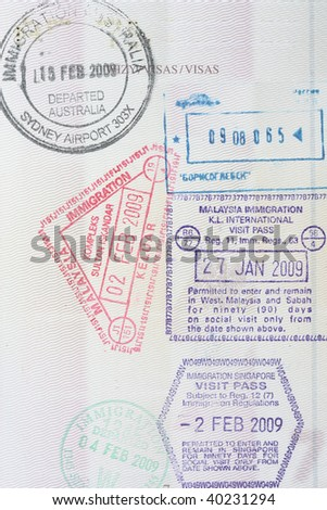 Stamps from Singapore, Australia, Malaysia immigration in a Polish passport - stock photo