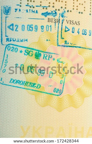 Stamps in foreign passport - stock photo