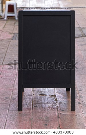 Stand alone black message board with empty space