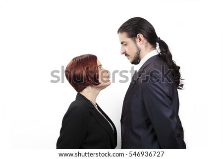 Man ponytail stock images royalty free images vectors stand off between a male and female partner with the shorter woman staring up belligerently into urmus Gallery