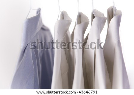 Stand out in the crowd with a blue dress shirt rather than a white shirt - stock photo