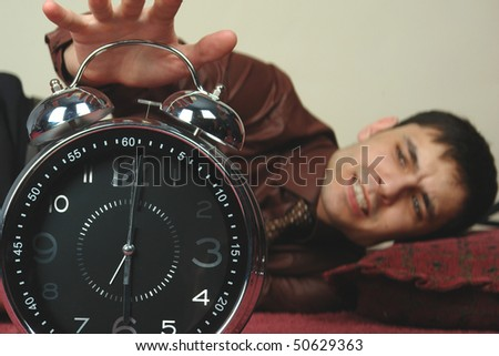 stand up angry man with clock - stock photo