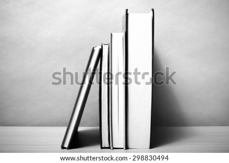 stand up of book on wood table background black and white color tone style