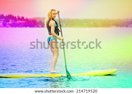 Stand up paddle boarder, colorful filtered image - stock photo