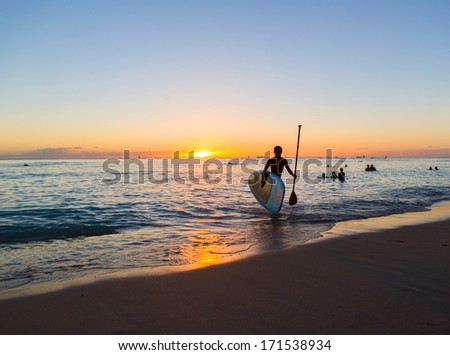 Stand Up Paddle rider in the sunset of Waikiki Beach on Oahu, Hawaii, - stock photo