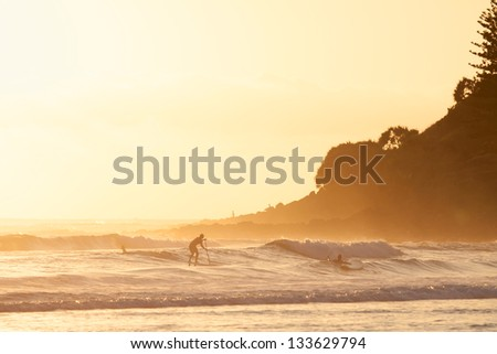Stand up paddle surfing in the morning  in Burleigh Heads (Gold Coast, QLD, Australia) - stock photo