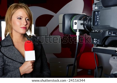 stand up transmission with serious press woman in front of the video camera - stock photo