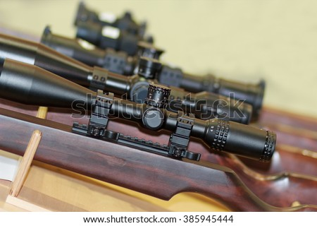 Stand with hunting rifles with telescopic sights. Weapon - stock photo