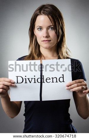 stand woman cutting paper in half with the word share dividend written on the paper
