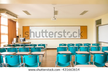 standard classroom interior with blue chair - stock photo