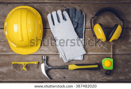 Standard construction safety equipment and Tools on wooden table. top view - stock photo