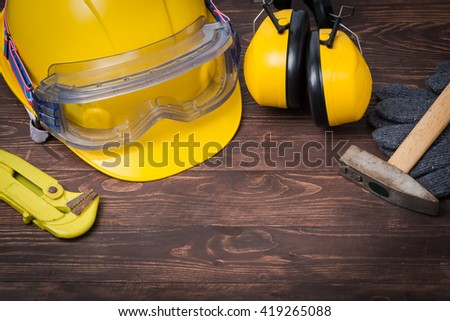 Standard construction safety , pipewrench and hammer for repair pipeline - stock photo