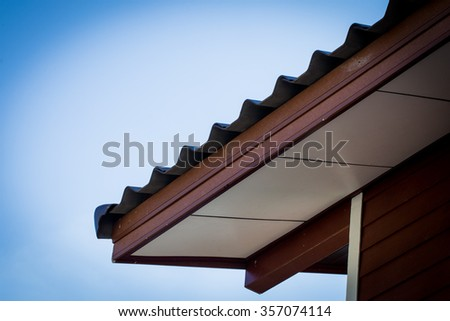 Standard Detail connection of roof tiles with gypsum board ceiling and eaves - stock photo