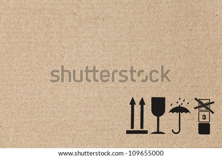 Standard signs on a flat brown cardboard box with copy space - stock photo