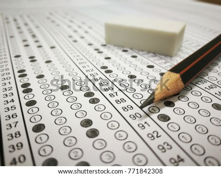 Standard test form or school answer sheet with answers bubbled in with pencil and eraser, focus on answer sheet