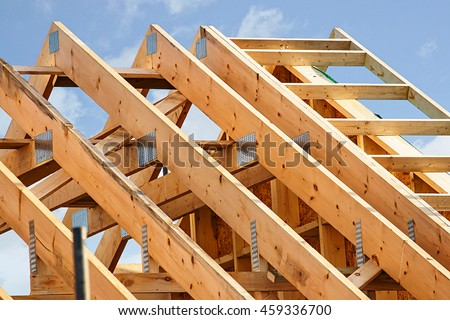 Standard timber framed building with close up on the roof trusses