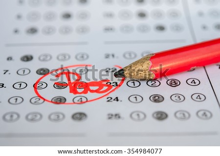 Standardized test form with answers bubbled in and a pencil, focus on pencil