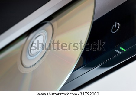 Standby button, LED and DVD disc. Selective focus. - stock photo