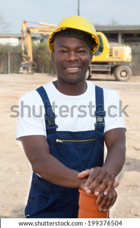 Standing african construction worker with pipe  - stock photo