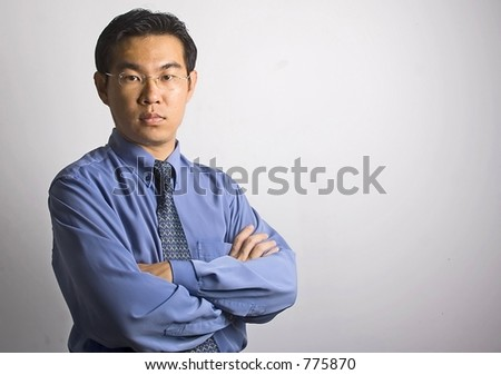 Standing Asian Businessman - stock photo