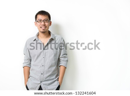 Standing Asian man isolated on white background - stock photo