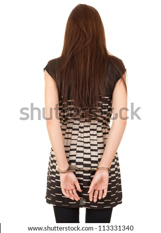 standing back young woman in handcuffs, white background - stock photo
