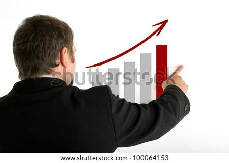 Standing behind a man shows his index finger on growth graph, white background