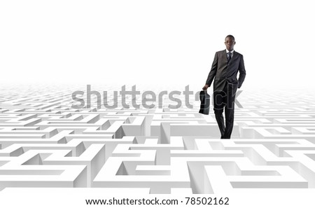 standing black man and 3d white maze - stock photo