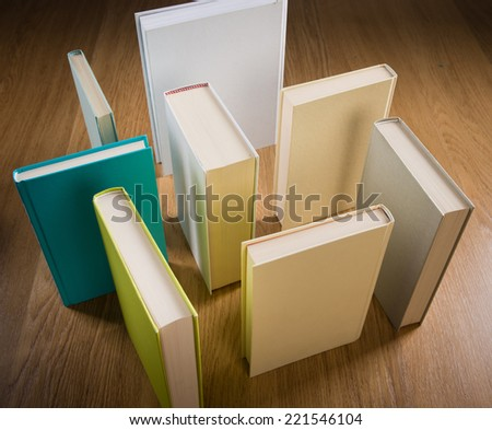 Standing books on floor composing a maze, learning and thinking concept. - stock photo