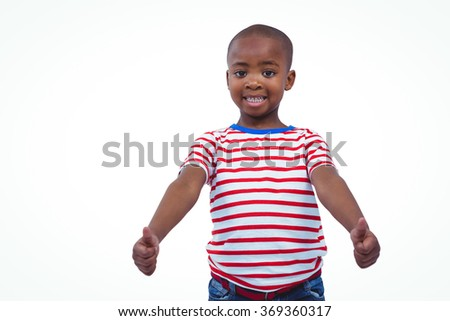 Standing boy showing thumbs to camera on white screen