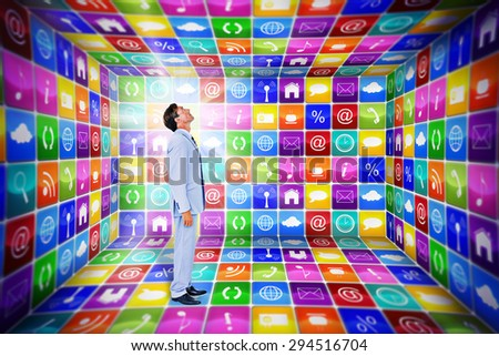 Standing businessman against app room Standing businessman on white background