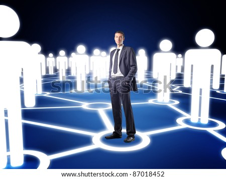 standing businessman and virtual community - stock photo