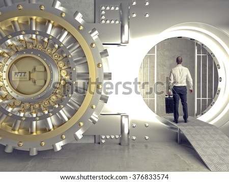 standing businessman look in bank vault