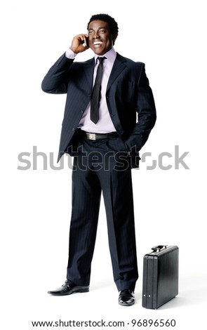 standing businessman on the phone with briefcase isolated on white