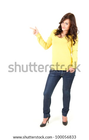 standing casual young woman pointing up, ful length, white background
