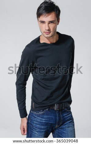 standing confident young man isolated  - stock photo