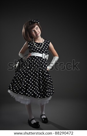 Standing elegant old-fashioned dressed little girl - stock photo