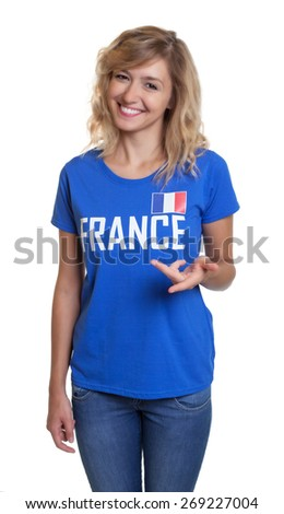 Standing french sports with blond hair and blue jersey - stock photo