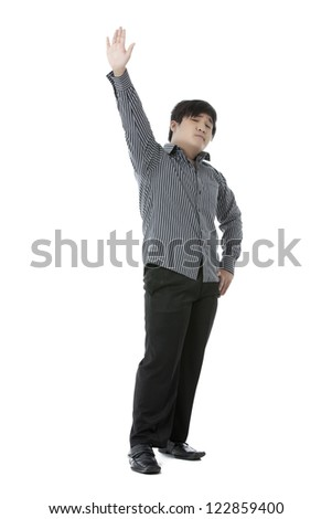 Standing good looking guy raising his hand and the other hand on hip isolated on - stock photo