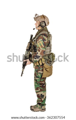 standing in woodland camouflage and modern machine gun. Isolated on white