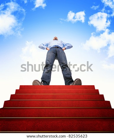 standing man and stair with red carpet - stock photo