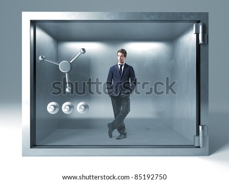 standing man in metal safe box - stock photo
