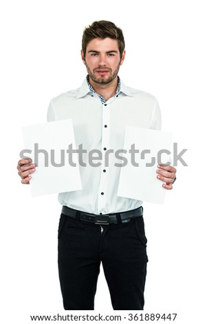 Standing man showing white papers on white screen