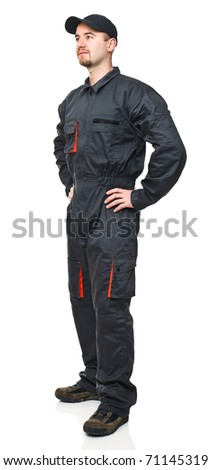 standing manual worker with garage suit isolated on white