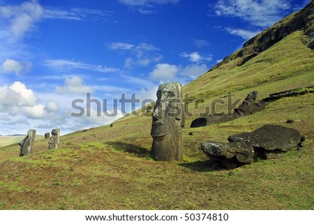Standing Moaia at Rapa Nui, Easter Island. These Monoliths were taken at the Rano Raraku quarry in the Chilean owned Easter Island (or Isla pascual). - stock photo