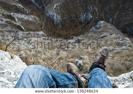 standing on the edge - stock photo
